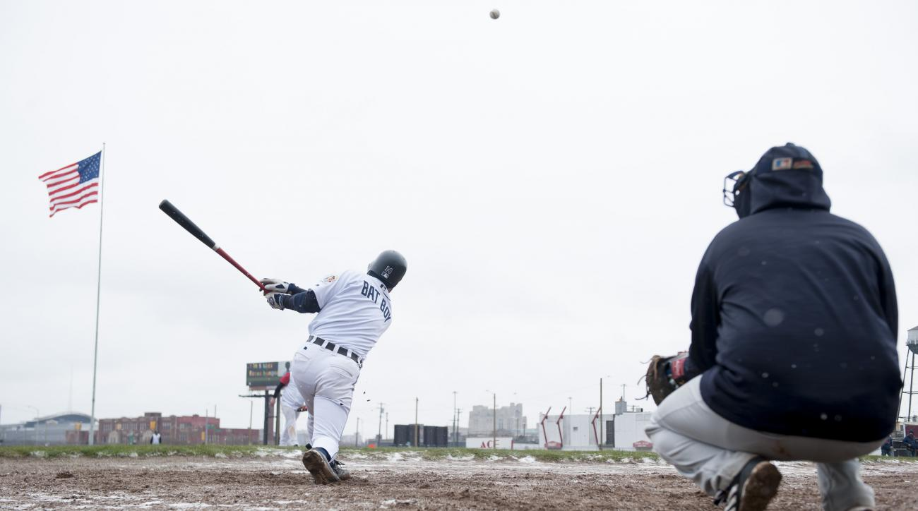 Eric Toysa, who was a bat boy at the old Tiger Stadium during its last season, hits the ball while warming up before a game on the site of the old stadium in Detroit, Sunday, April 10, 2016. Volunteers and baseball fans gathered over the weekend at the si