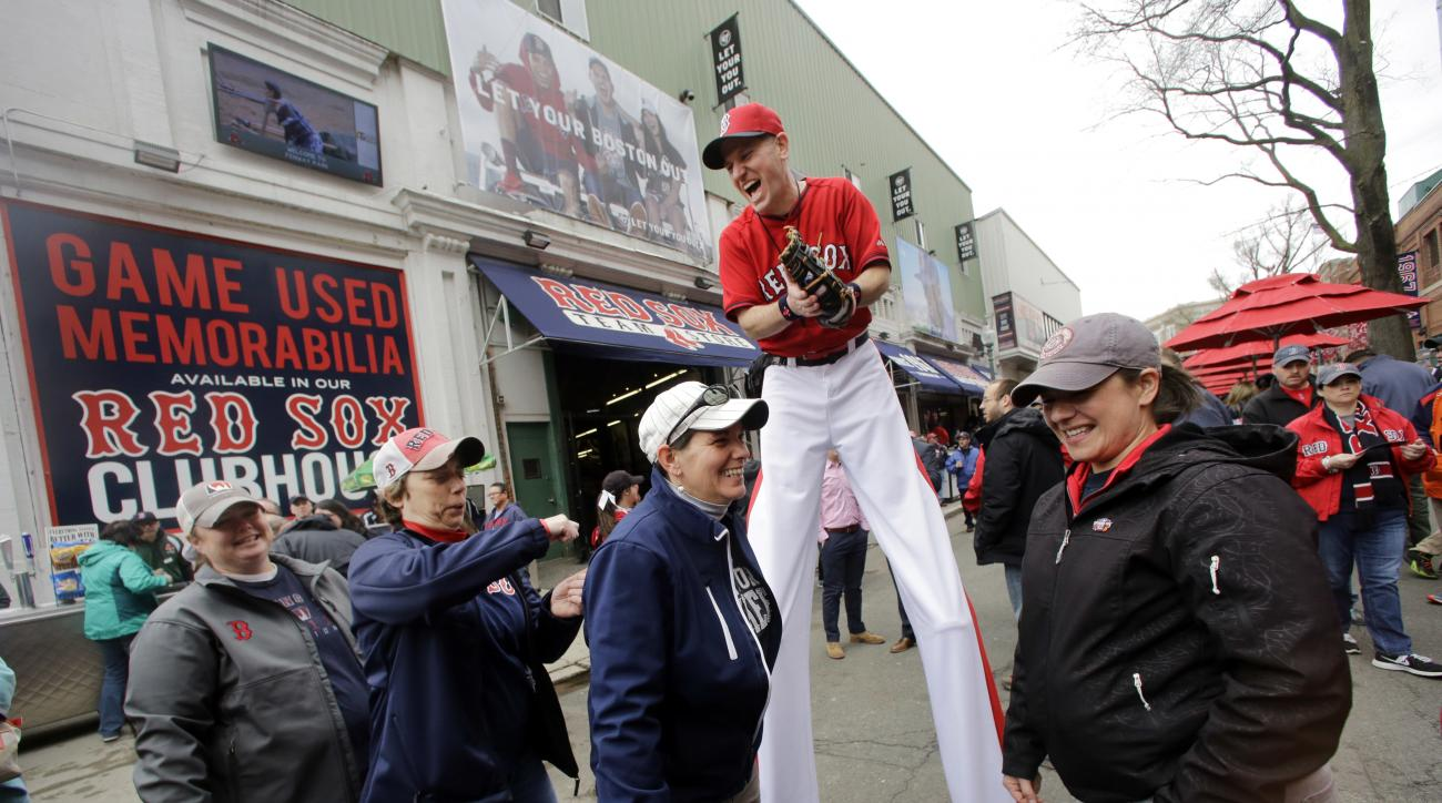 """""""Big League Brian"""" on stilts laughs with fans on Yawkey Way before the home opener baseball game between the Boston Red Sox and the Baltimore Orioles at Fenway Park, Monday, April 11, 2016, in Boston. (AP Photo/Elise Amendola)"""