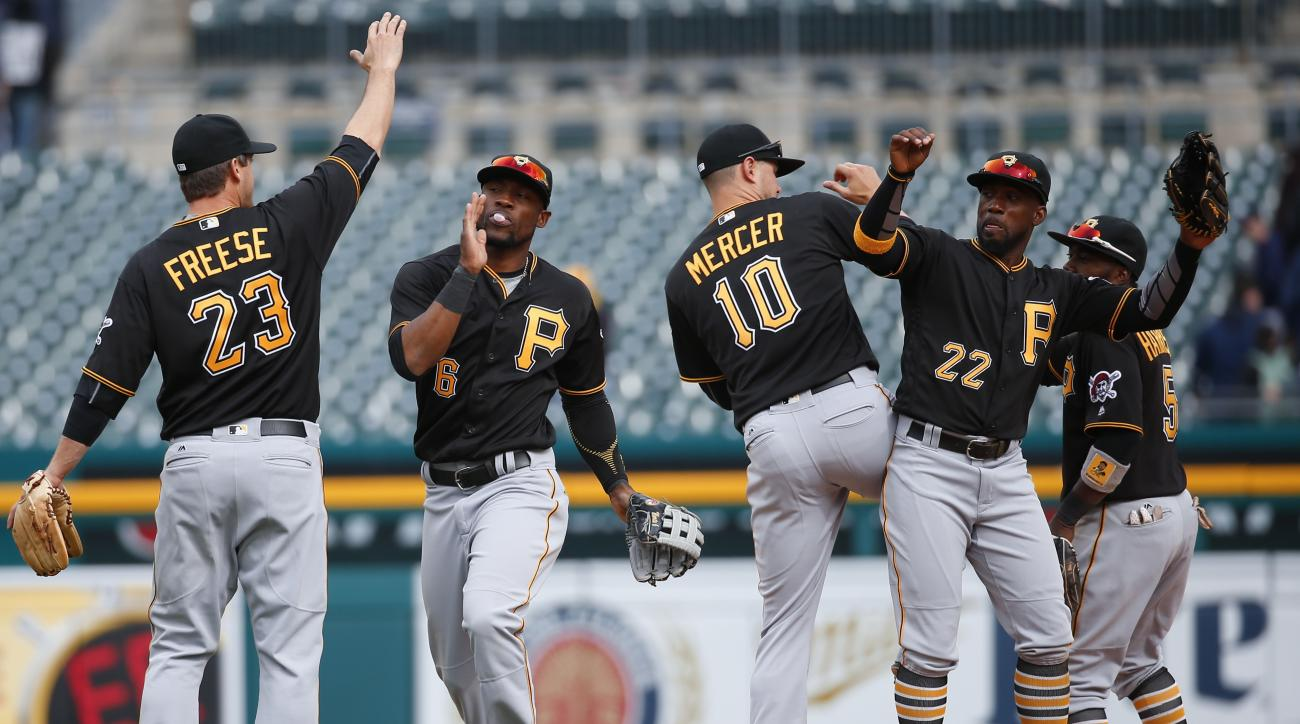Pittsburgh Pirates players celebrate their 7-4 win over the Detroit Tigers in a baseball game, Monday, April 11, 2016, in Detroit. (AP Photo/Paul Sancya)