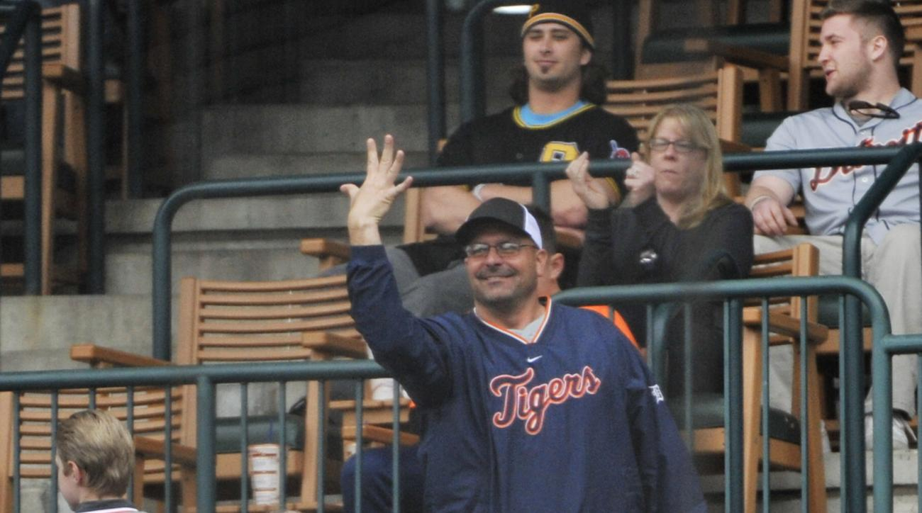Bill Dugan of Roseville, Mich., shows that he caught five foul balls during the Detroit Tigerss Pittsburgh Pirates at Comerica Park in Detroit on Monday,  April 11, 2016. Dugan, who gave all five to nearby kids, was sitting behind home plate, in an area n