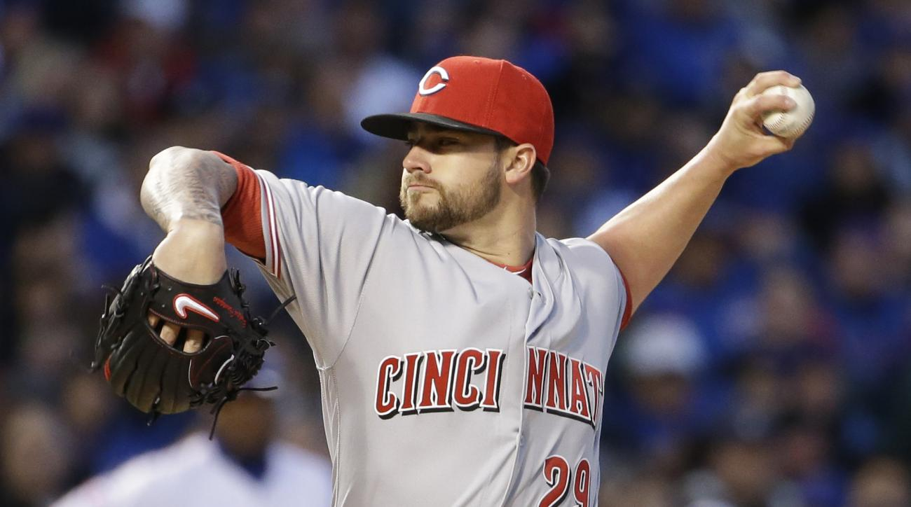 Cincinnati Reds starter Brandon Finnegan throws against the Chicago Cubs during the first inning of an opening baseball game Monday, April 11, 2016, in Chicago. (AP Photo/Nam Y. Huh)