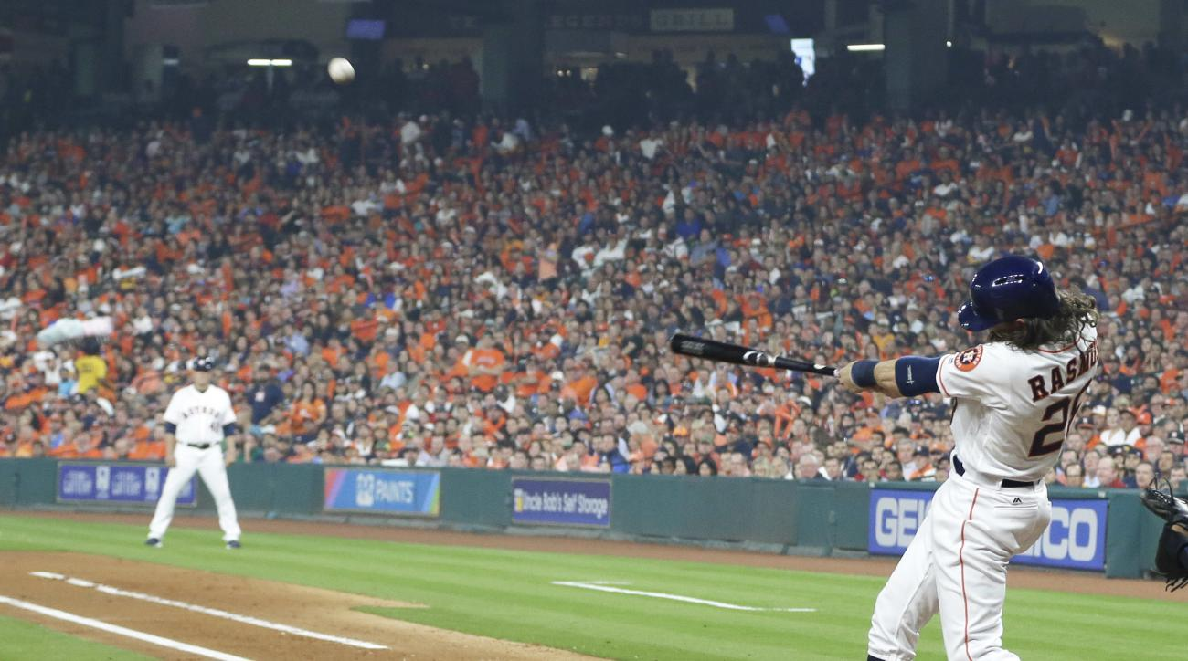 Houston Astros' Colby Rasmus hits a two-run homer against the Kansas City Royals in the first inning of a baseball game Monday, April 11, 2016, in Houston. (AP Photo/Pat Sullivan)