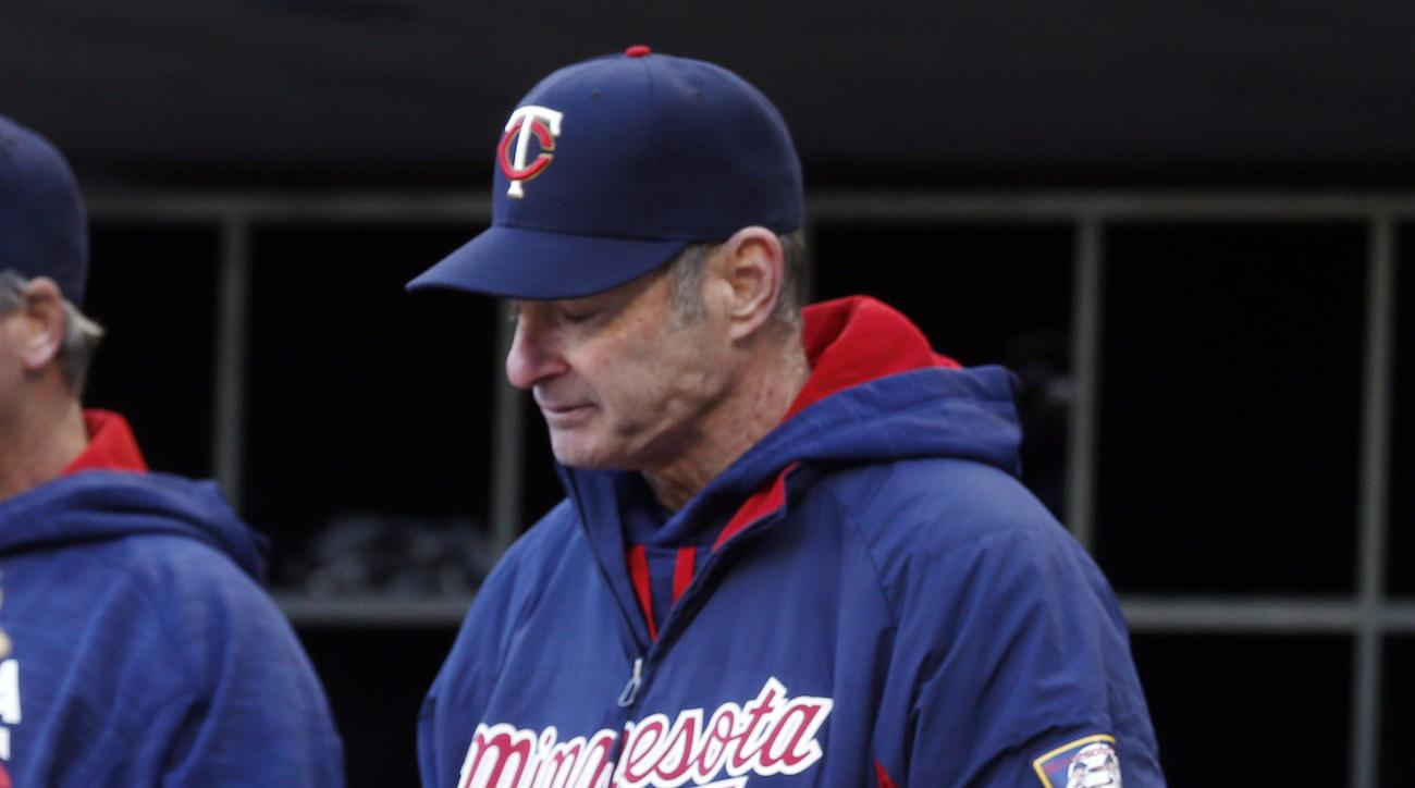 In this April 11, 2016 photo, Minnesota Twins manager Paul Molitor looks down in the waning minutes of a 4-1 loss to the Chicago White Sox in a baseball game in Minneapolis. The Twins are the only winless team left in the American League, off to the franc