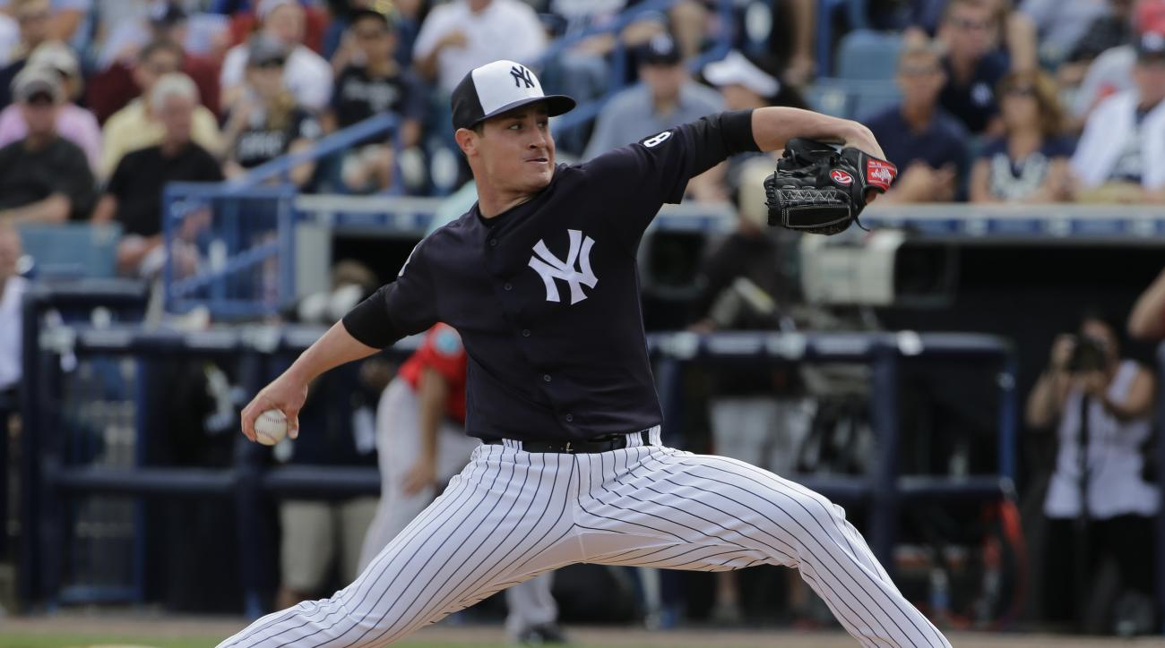 FILE - In this March 5, 2016, file photo, New York Yankees relief pitcher Nick Rumbelow delivers to the Boston Red Sox during a spring training baseball game in Tampa, Fla. Yankees reliever Nick Rumbelow has a torn elbow ligament and needs Tommy John surg