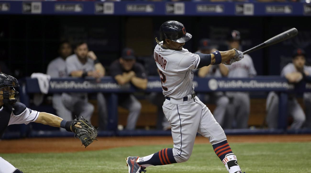 Cleveland Indians' Francisco Lindor connects for a home run off Tampa Bay Rays starting pitcher Matt Moore during the fourth inning of a baseball game Tuesday, April 12, 2016, in St. Petersburg, Fla. Catching for the Rays is Hank Conger. (AP Photo/Chris O