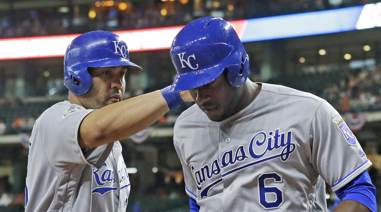 Kansas City Royals' Lorenzo Cain (6) is congratulated by Kendrys Morales on a three-run home run against the Houston Astros during the first inning of a baseball game Tuesday, April 12, 2016, in Houston. (AP Photo/Pat Sullivan)