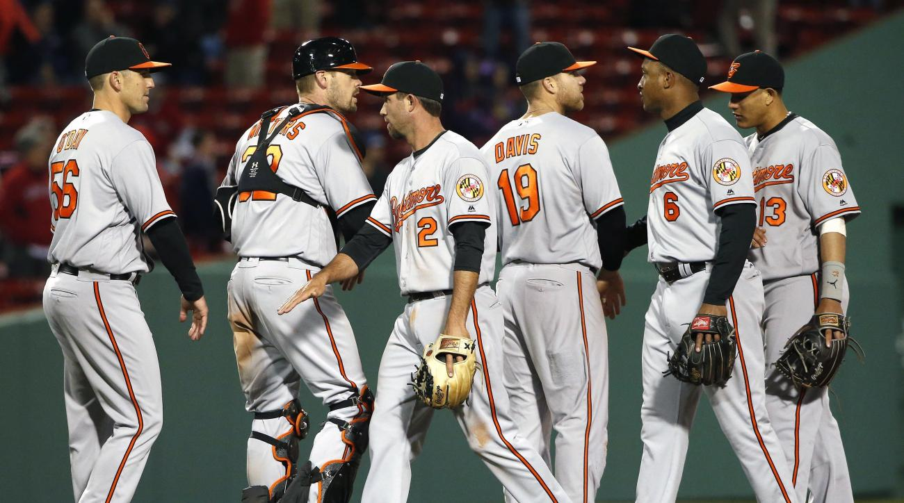 Baltimore Orioles' J.J. Hardy (2) and teammates celebrate after defeating the Boston Red Sox 9-5 in a baseball game in Boston, Tuesday, April 12, 2016. (AP Photo/Michael Dwyer)