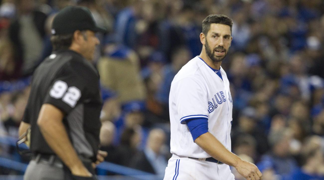 Toronto Blue Jays' Chris Colabello has words with home plate umpire James Hoye after a called third strike in the ninth inning of the team's baseball game against the New York Yankees on Tuesday, April 12, 2016, in Toronto. The Yankees won 3-2. (Fred Thor
