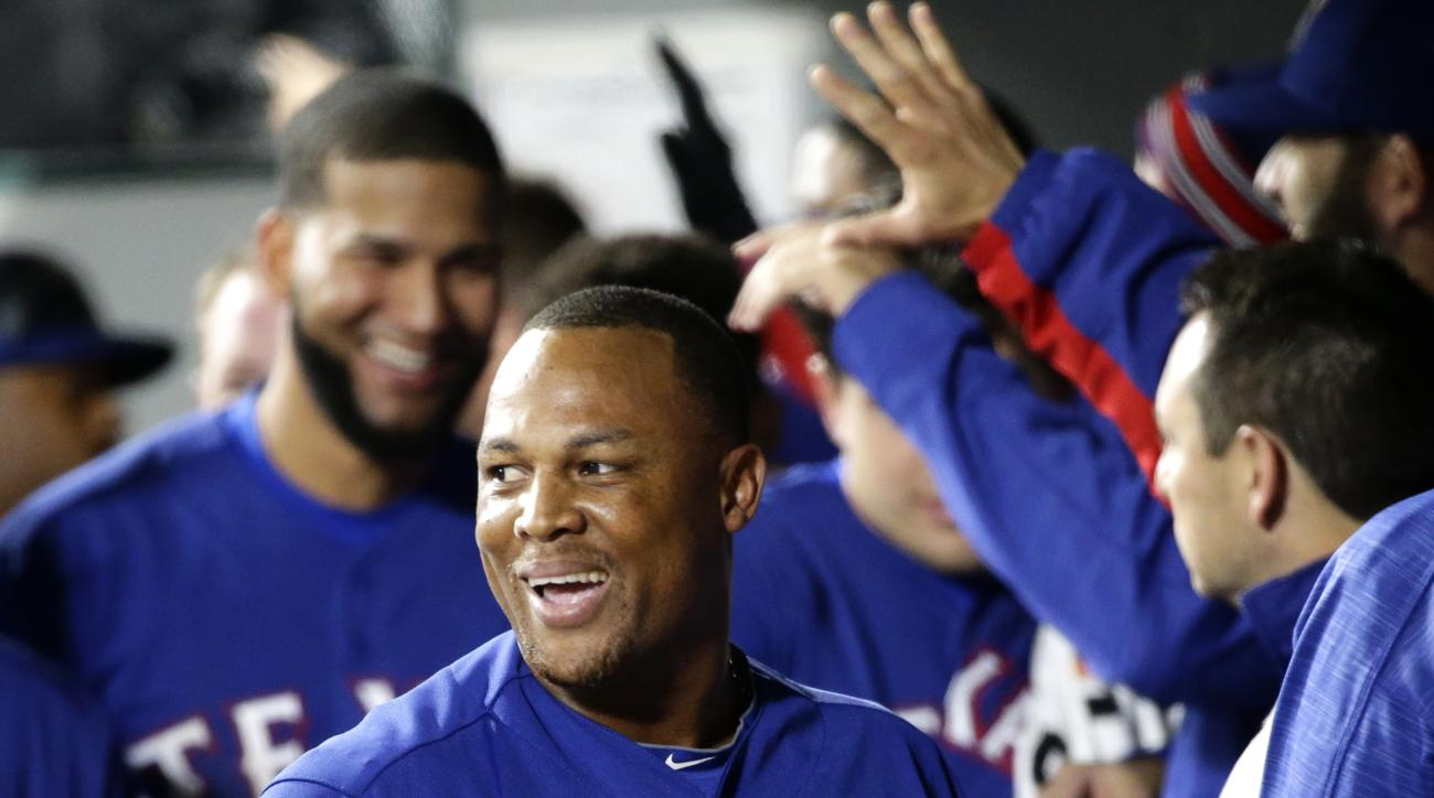 Texas Rangers' Adrian Beltre smiles in the dugout after he hit a three-run home run during the third inning of a baseball game against the Seattle Mariners, Tuesday, April 12, 2016, in Seattle. (AP Photo/Ted S. Warren)