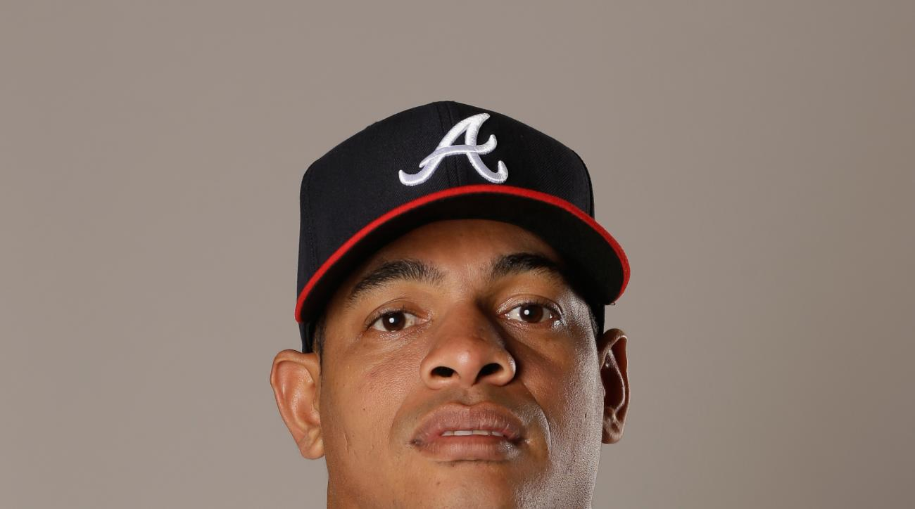 In this photo taken Feb. 26, 2016 photo, Hector Olivera of the Atlanta Braves baseball team., in Kissimmee, Fla. Police have arrested Atlanta Braves outfielder Hector Olivera after a woman accused him of assault at a hotel in Arlington, Va.  (AP Photo/Joh