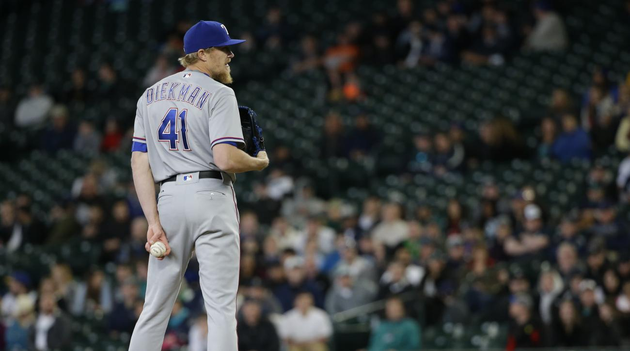 Texas Rangers pitcher Jake Diekman stands on the mound in the tenth inning of a baseball game against the Seattle Mariners, Wednesday, April 13, 2016, in Seattle. Later in the inning Diekman gave up a two-run walk-off home run to Seattle Mariners' Dae-Ho