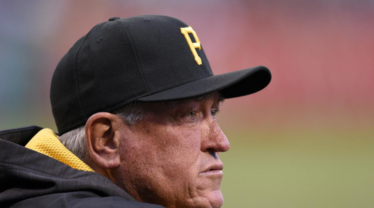 Pittsburgh Pirates manager Clint Hurdle (13) looks out from the dugout during the first inning of a baseball game against Detroit Tigers on Wednesday, April 13, 2016, in Pittsburgh. (AP Photo/Don Wright)