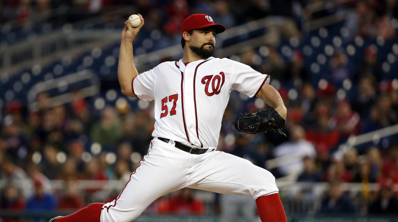 Washington Nationals starting pitcher Tanner Roark throws during the third inning of a baseball game against the Atlanta Braves at Nationals Park, Wednesday, April 13, 2016, in Washington. (AP Photo/Alex Brandon)