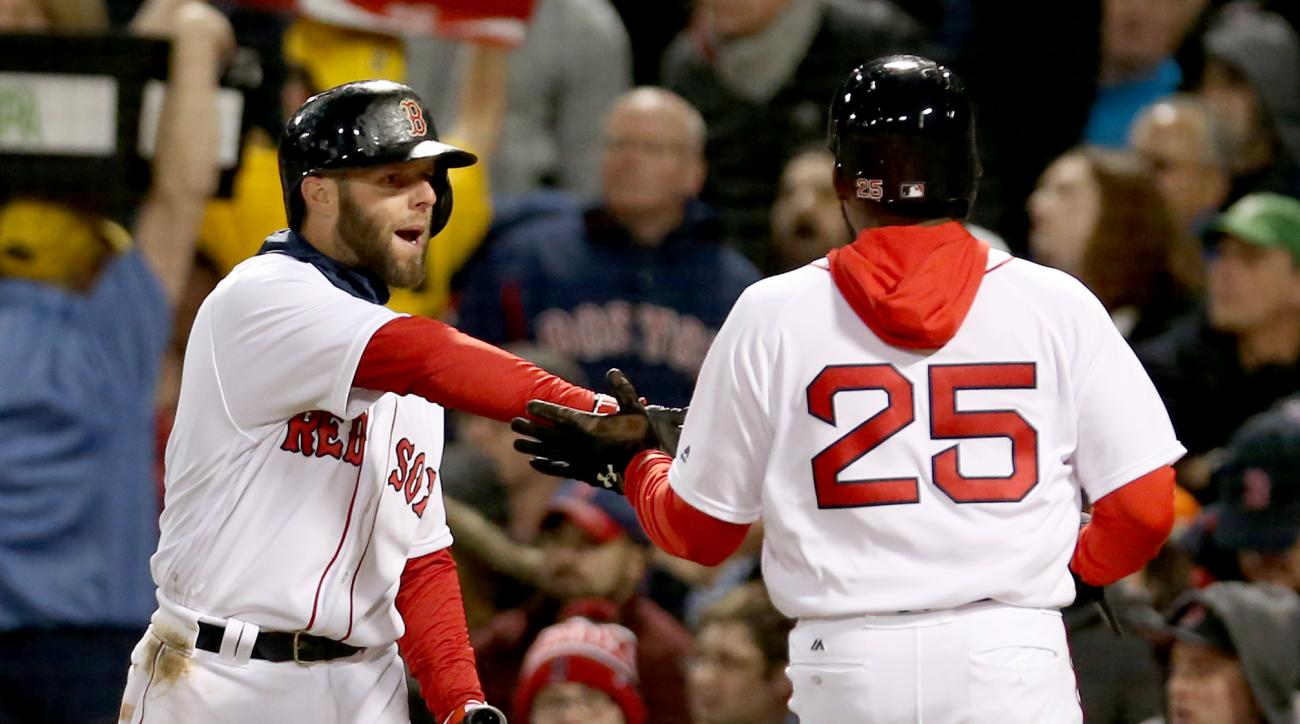 Boston Red Sox's Jackie Bradley Jr. (25) is congratulated by teammate Dustin Pedroia after scoring on a ground out by Mookie Betts during the fourth inning of a baseball game against the Baltimore Orioles at Fenway Park, Wednesday, April 13, 2016, in Bost