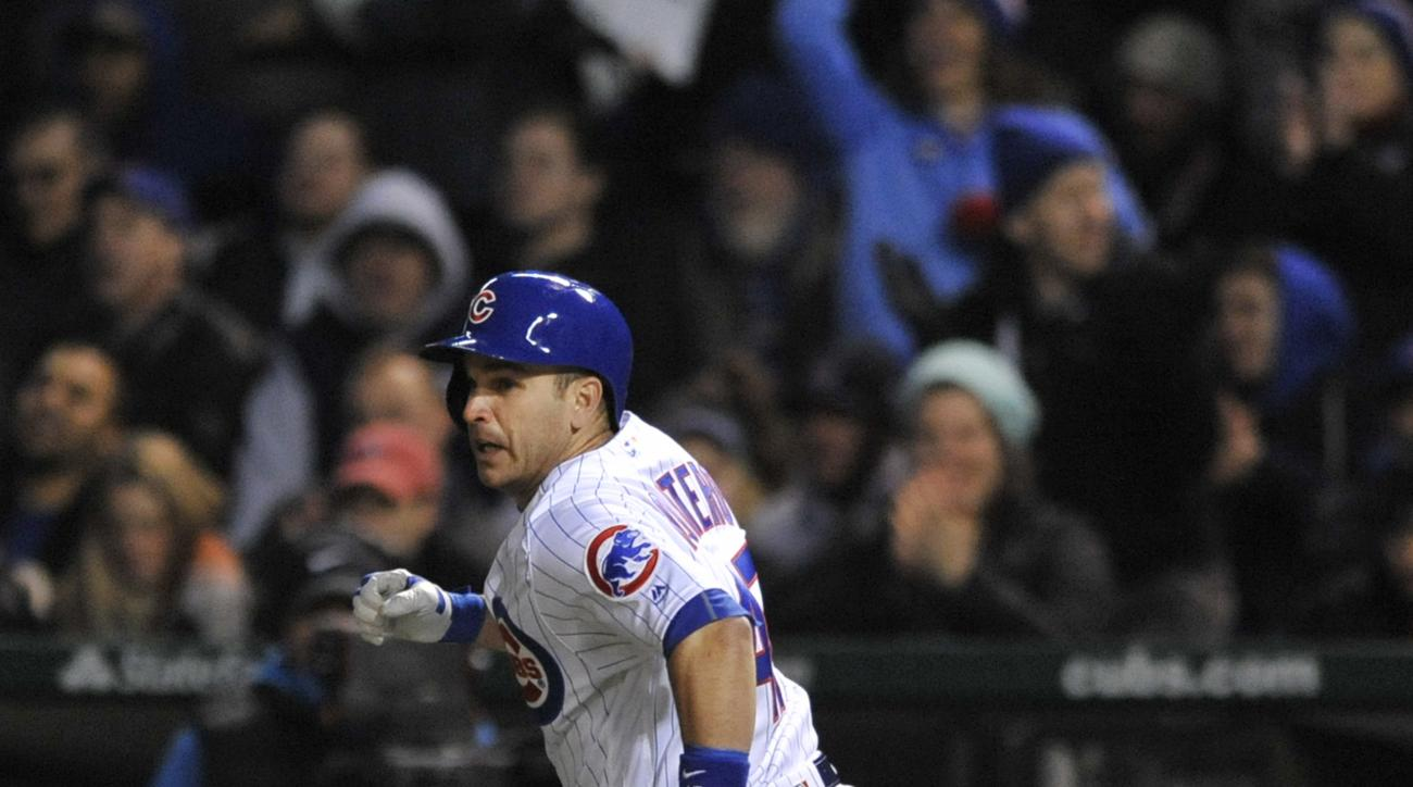 Chicago Cubs' Miguel Montero watches his RBI single during the first inning of a baseball game against the Cincinnati Reds Wednesday, April 13, 2016, in Chicago. (AP Photo/Paul Beaty)
