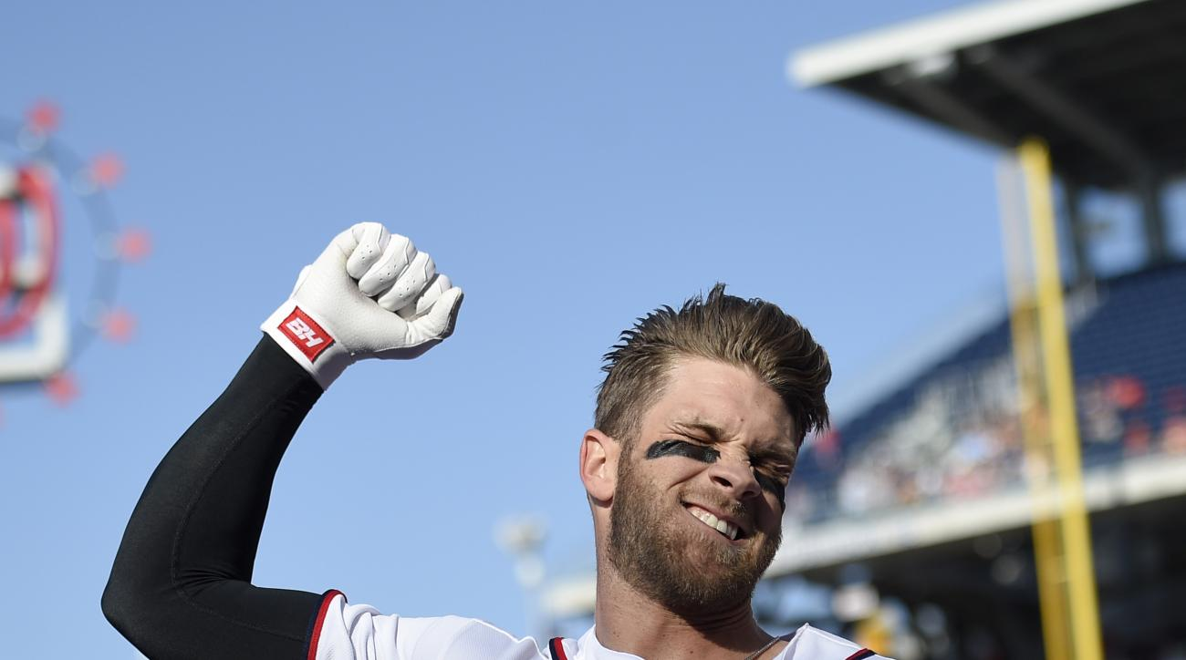 Washington Nationals' Bryce Harper pumps his fist as he takes a curtain call after he hit a grand slam during the third  inning of an baseball game against the Atlanta Braves, Thursday, April 14, 2016, in Washington. This was Harper's 100th home run of hi