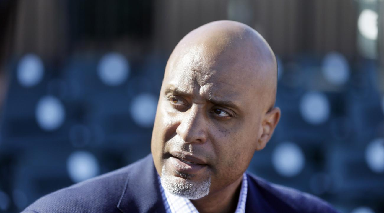 FILE - In this March 17, 2015, file photo, Tony Clark, head of the baseball players' union, talks to the media before a spring training baseball game between the Detroit Tigers and the Washington Nationals in Lakeland, Fla. THe union is frustrated many of