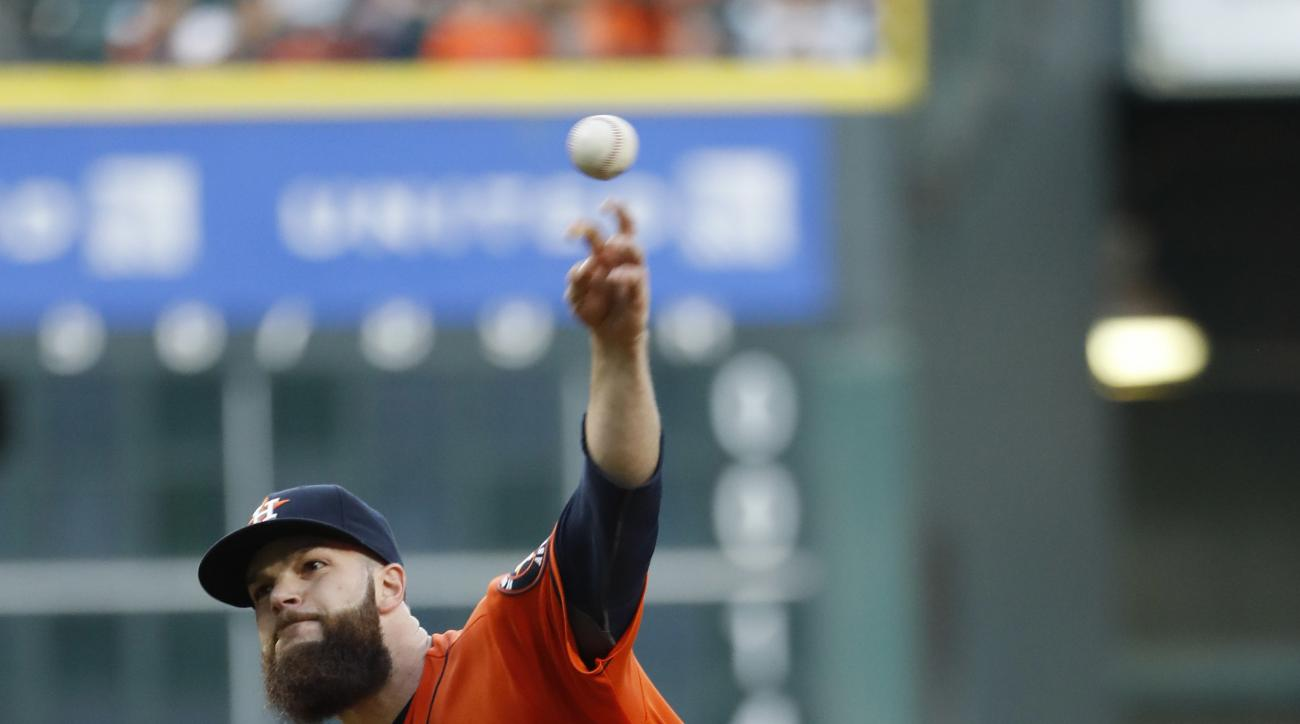 Houston Astros starting pitcher Dallas Keuchel throws against the Detroit Tigers during the first inning of a baseball game Friday, April 15, 2016, in Houston. (AP Photo/David J. Phillip)