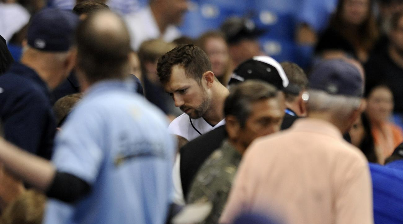Tampa Bay Rays designated hitter Steve Souza Jr., center, looks on as medical personnel help a fan in the stands who was hit by his foul ball during the seventh inning of a baseball game against the Chicago White Sox, Friday, April 15, 2016, in St. Peters
