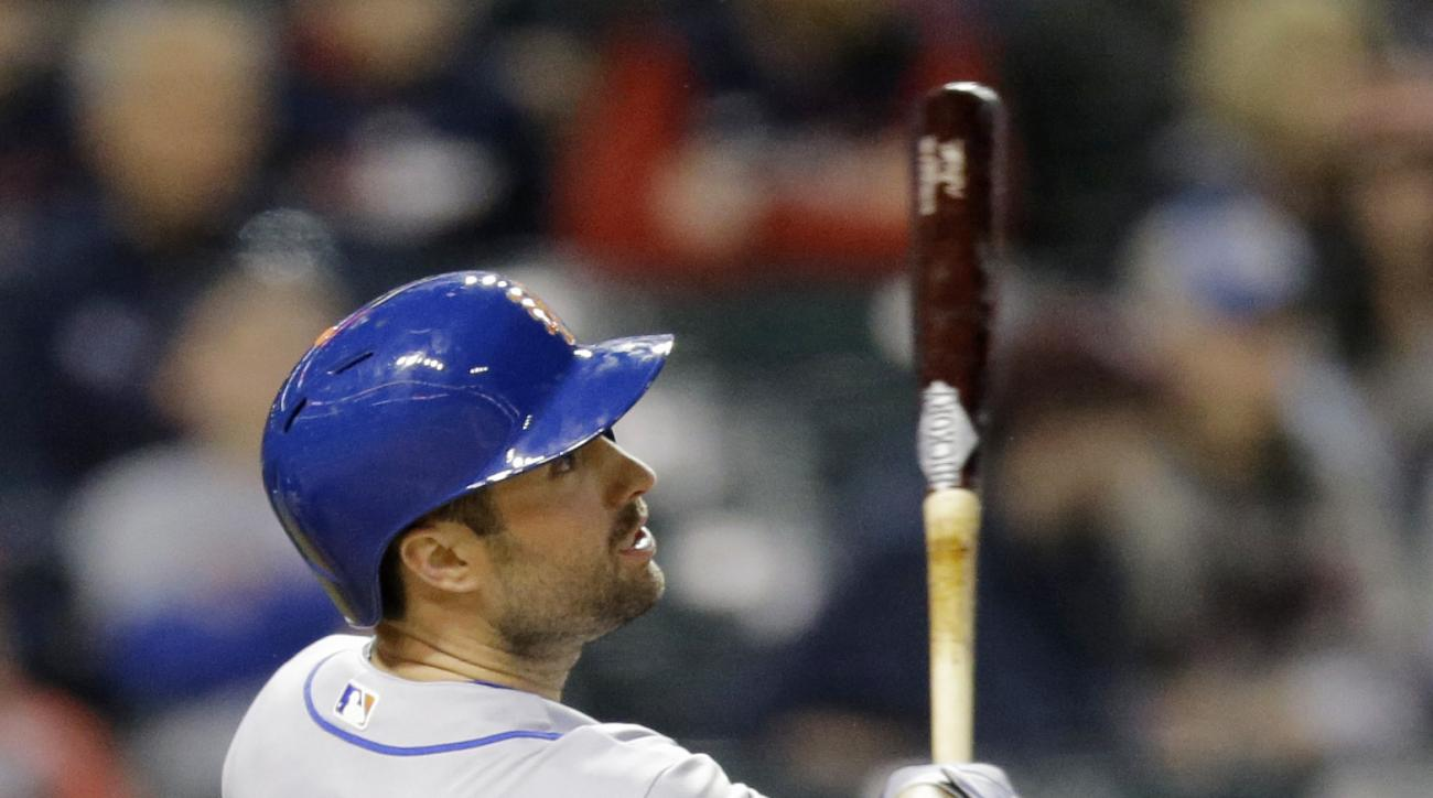 New York Mets' Neil Walker watches his two-run home run off Cleveland Indians relief pitcher Ross Detwiler in the fifth inning of an interleague baseball game, Friday, April 15, 2016, in Cleveland. (AP Photo/Tony Dejak)