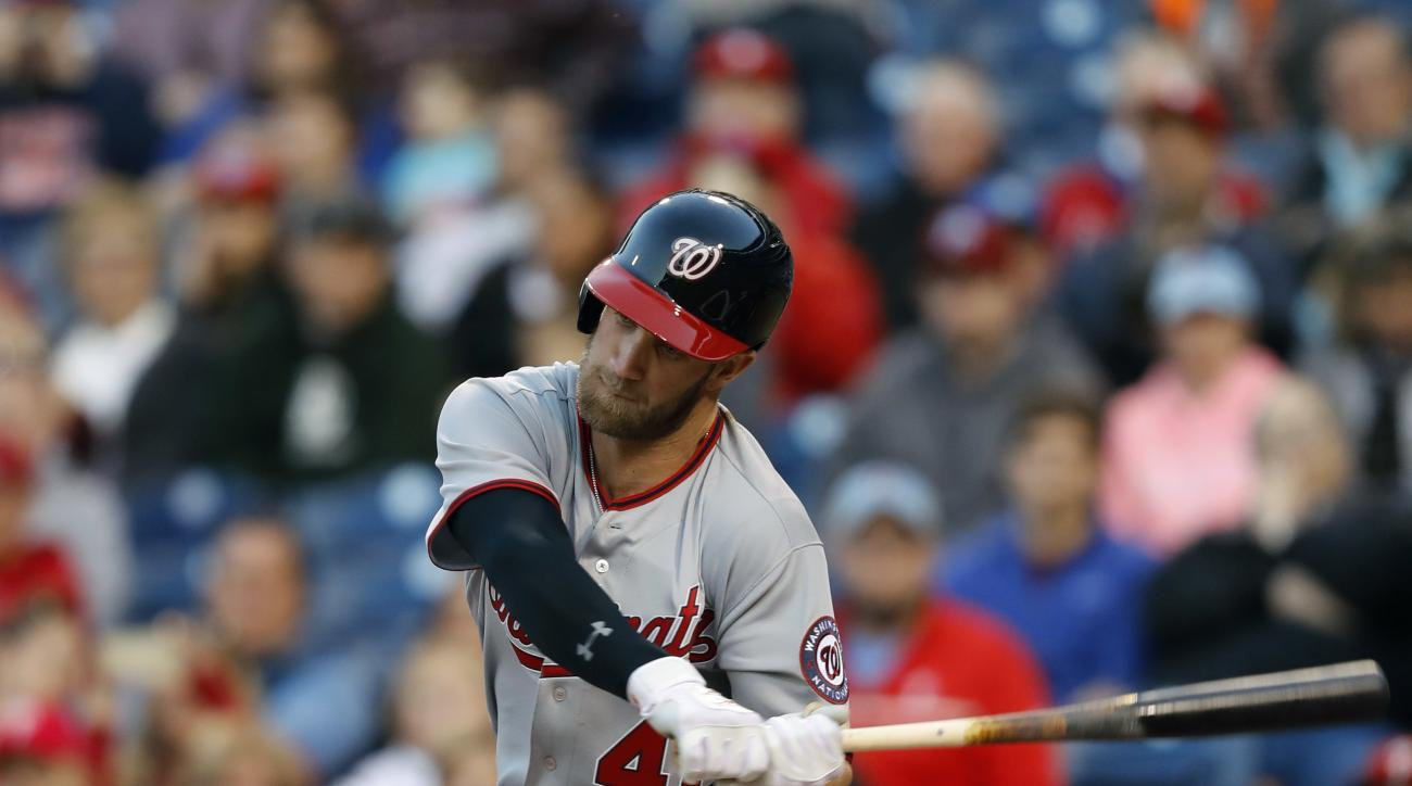 Washington Nationals' Bryce Harper swings for a single off Philadelphia Phillies starting pitcher Jeremy Hellickson during the first inning of a baseball game, Friday, April 15, 2016, in Philadelphia. The Nationals won 9-1. (AP Photo/Matt Slocum)