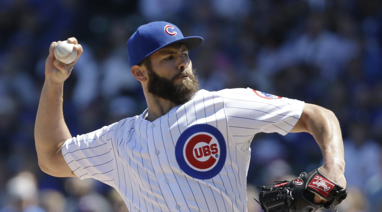 Chicago Cubs starter Jake Arrieta throws against the Colorado Rockies during the first inning of a baseball game Saturday, April 16, 2016, in Chicago. (AP Photo/Nam Y. Huh)