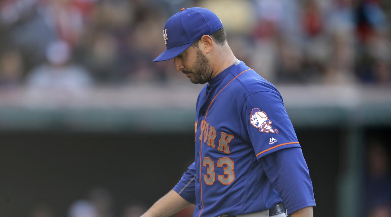 New York Mets starting pitcher Matt Harvey walks to the dugout in the sixth inning of an interleague baseball game against the Cleveland Indians, Saturday, April 16, 2016, in Cleveland. (AP Photo/Tony Dejak)