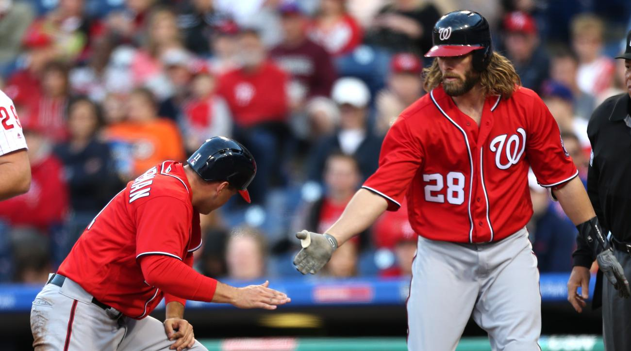 Washington Nationals first baseman Ryan Zimmerman is congratulated by Jayson Werth (28) after scoring on a triple by Daniel Murphy (20) on a pitch by the Philadelphia Phillies' Aaron Nola in the first inning of a baseball game, Saturday, April 16, 2016, i