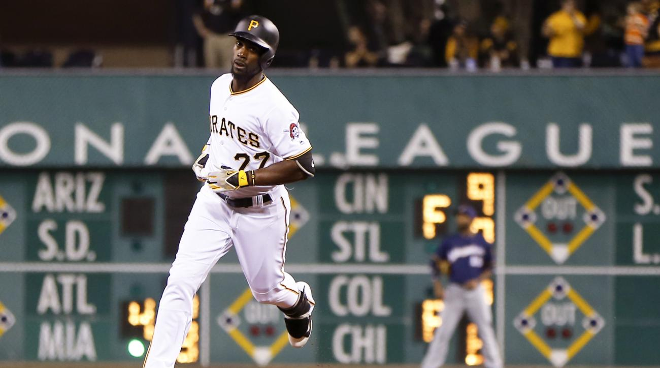 Pittsburgh Pirates' Andrew McCutchen (22) rounds second base past Milwaukee Brewers right fielder Domingo Santana after hitting a solo home run in the fifth inning of a baseball game, Saturday, April 16, 2016, in Pittsburgh. (AP Photo/Keith Srakocic)