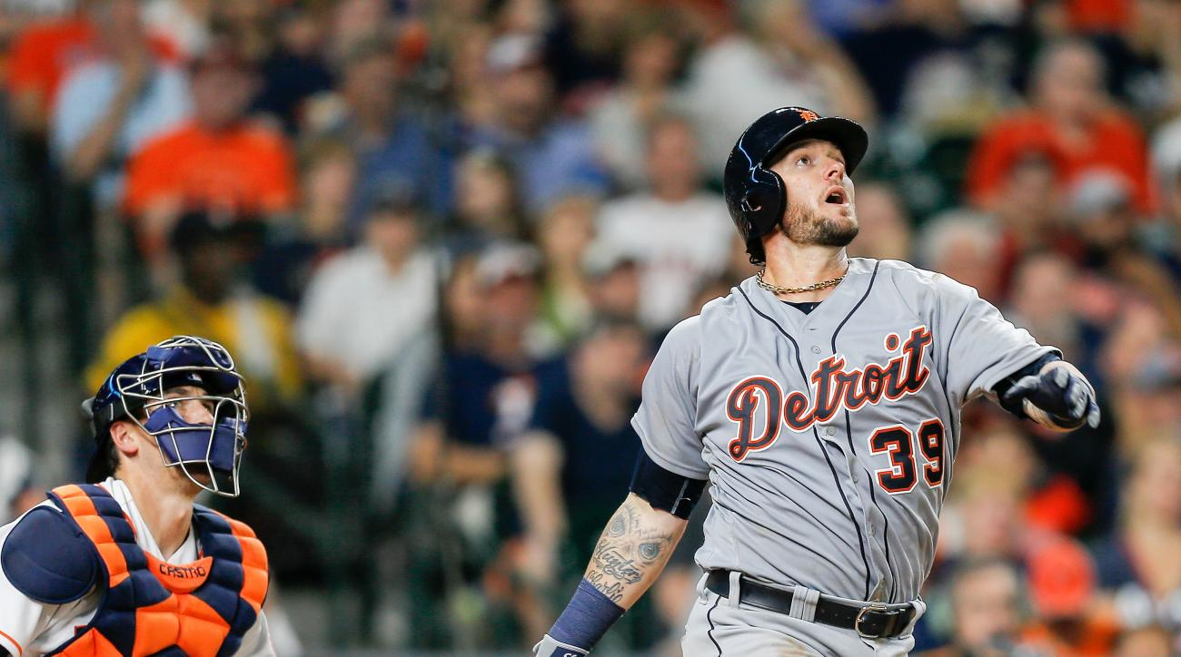 Detroit Tigers' Jarrod Saltalamacchia and Houston Astros catcher Jason Castro watch Saltalamacchia's home run during a baseball game Saturday, April 16, 2016, in Houston. (AP Photo/Bob Levey)