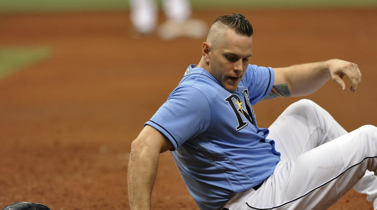 Tampa Bay Rays' Logan Morrison picks himself up after he was picked off on a throw to first base from Chicago White Sox catcher Dioner Navarro during the third inning of a baseball game Sunday, April 17, 2016, in St. Petersburg, Fla. (AP Photo/Steve Nesiu