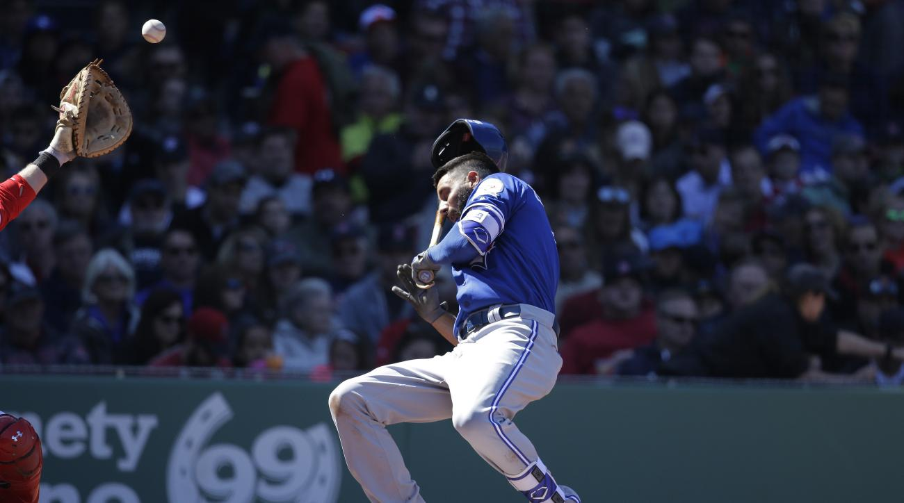 Toronto Blue Jays' Chris Colabello is hit by a pitch in the fourth inning of a baseball game against the Boston Red Sox at Fenway Park, Sunday, April 17, 2016, in Boston. (AP Photo/Steven Senne)