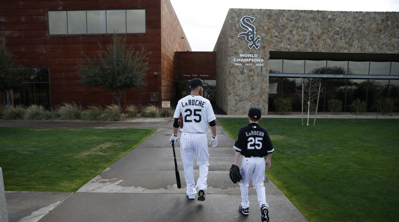 Chicago White Sox's Adam LaRoche, left, and his son Drake walk to the White Sox clubhouse during a photo day before a baseball spring training workout, Saturday, Feb. 28, 2015, in Phoenix. (AP Photo/John Locher)