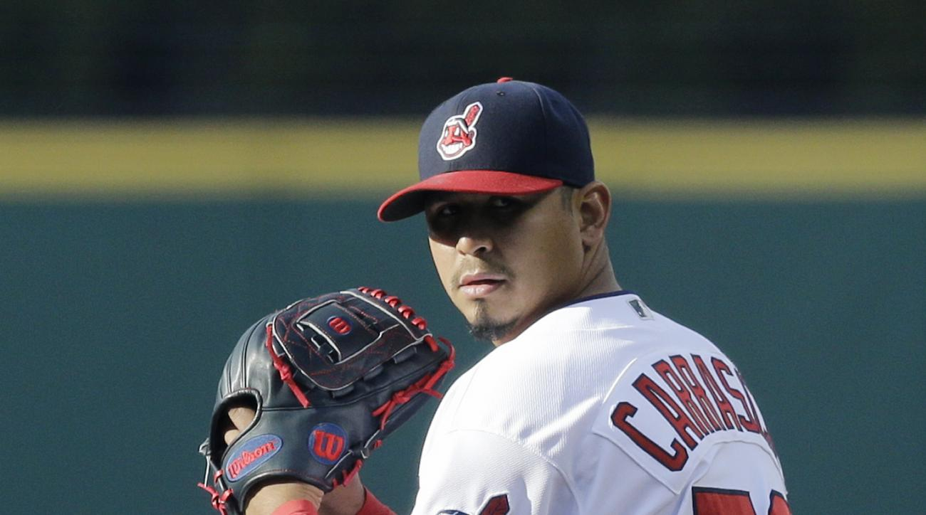 Cleveland Indians starting pitcher Carlos Carrasco delivers in the first inning of a baseball game against the Seattle Mariners, Tuesday, April 19, 2016, in Cleveland. (AP Photo/Tony Dejak)