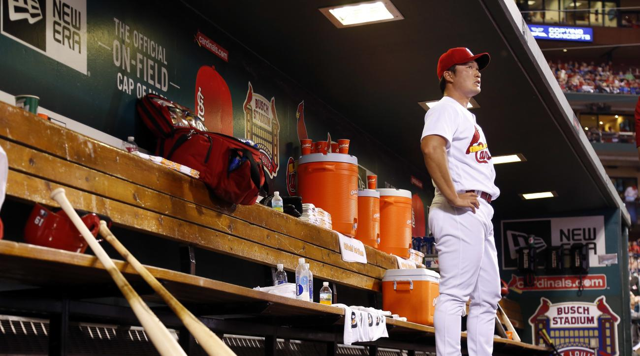 St. Louis Cardinals relief pitcher Seung Hwan Oh, of South Korea, stands in the dugout after working during the sixth inning of a baseball game against the Chicago Cubs Tuesday, April 19, 2016, in St. Louis. (AP Photo/Jeff Roberson)
