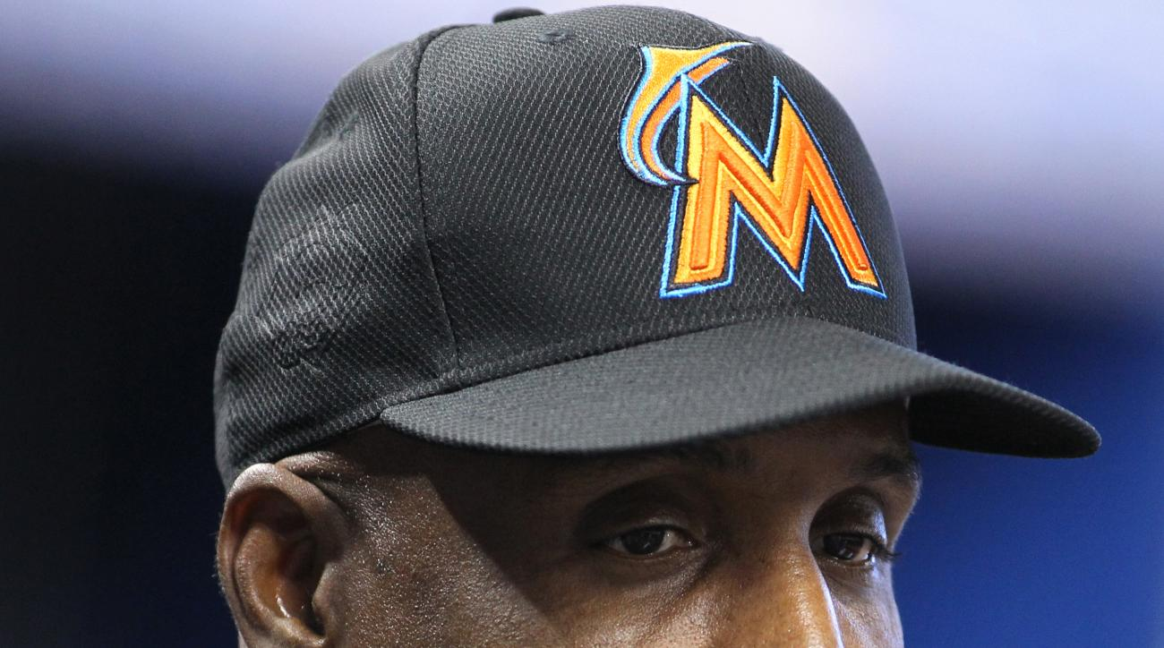 Miami Marlins hitting coach Barry Bonds listen to a member of the media before a baseball game against the Washington Nationals Wednesday, April 20, 2016, in Miami. (AP Photo/Luis M. Alvarez)