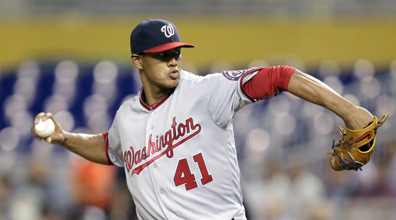 Washington Nationals starting pitcherJoe Ross throws during the first inning of a baseball game against the Miami Marlins Wednesday, April 20, 2016, in Miami. (AP Photo/Luis M. Alvarez)