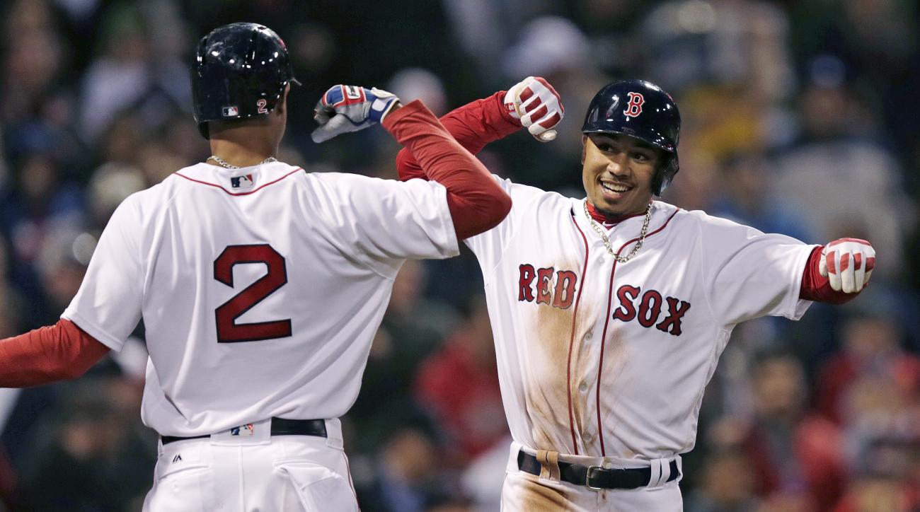 Boston Red Sox's Mookie Betts, right, is congratulated by Xander Bogaerts (2) after his two-run, home run in the second inning of a baseball game against the Tampa Bay Rays in Boston, Wednesday, April 20, 2016. (AP Photo/Charles Krupa)