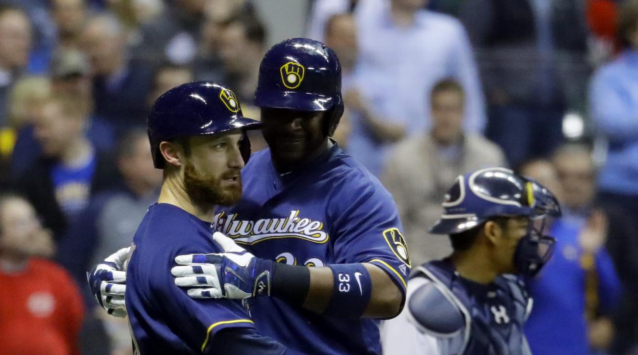Milwaukee Brewers' Chris Carter celebrates his two-run home run with Jonathan Lucroy during the seventh inning of a baseball game against the Minnesota Twins Wednesday, April 20, 2016, in Milwaukee. (AP Photo/Morry Gash)