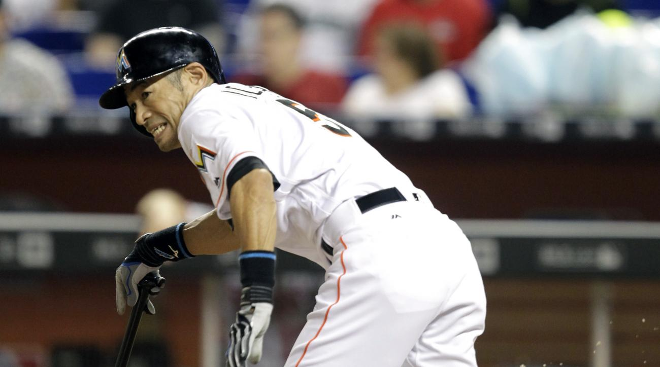 Miami Marlins Ichiro Suzuki watches the ball at third base as he grounds out into a double play during the first inning of a baseball game against the Washington Nationals Wednesday, April 20, 2016, in Miami. The Nationals won 3-1. (AP Photo/Luis M. Alvar
