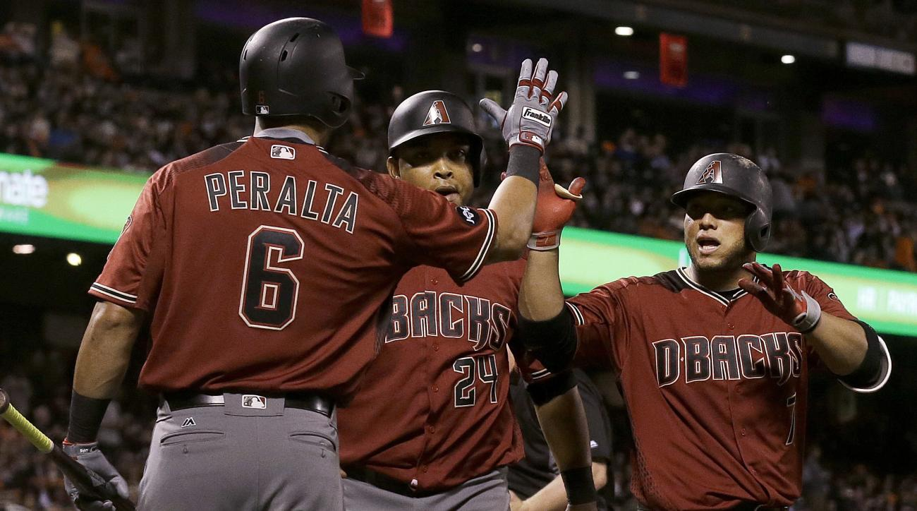 Arizona Diamondbacks' Welington Castillo, right, is congratulated by David Peralta (6) after hitting a two-run home run that scored Yasmany Tomas, center, during the seventh inning of a baseball game against the San Francisco Giants in San Francisco, Wedn
