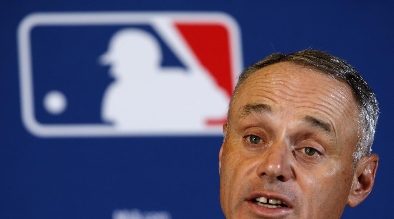 FILE - In this Feb. 22, 2016, file photo, Major League Baseball Commissioner Rob Manfred answers a question during a news conference in Phoenix. Manfred says this generation of players will make its own unwritten rules on what emotion is acceptable to sho