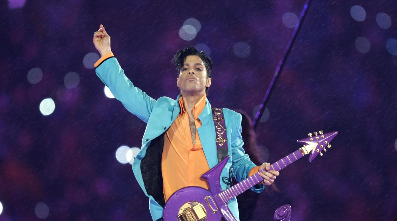 FILE - In this Feb. 4, 2007 file photo, Prince performs during the halftime show at the Super Bowl XLI football game at Dolphin Stadium in Miami. Prince, widely acclaimed as one of the most inventive and influential musicians of his era with hits includin