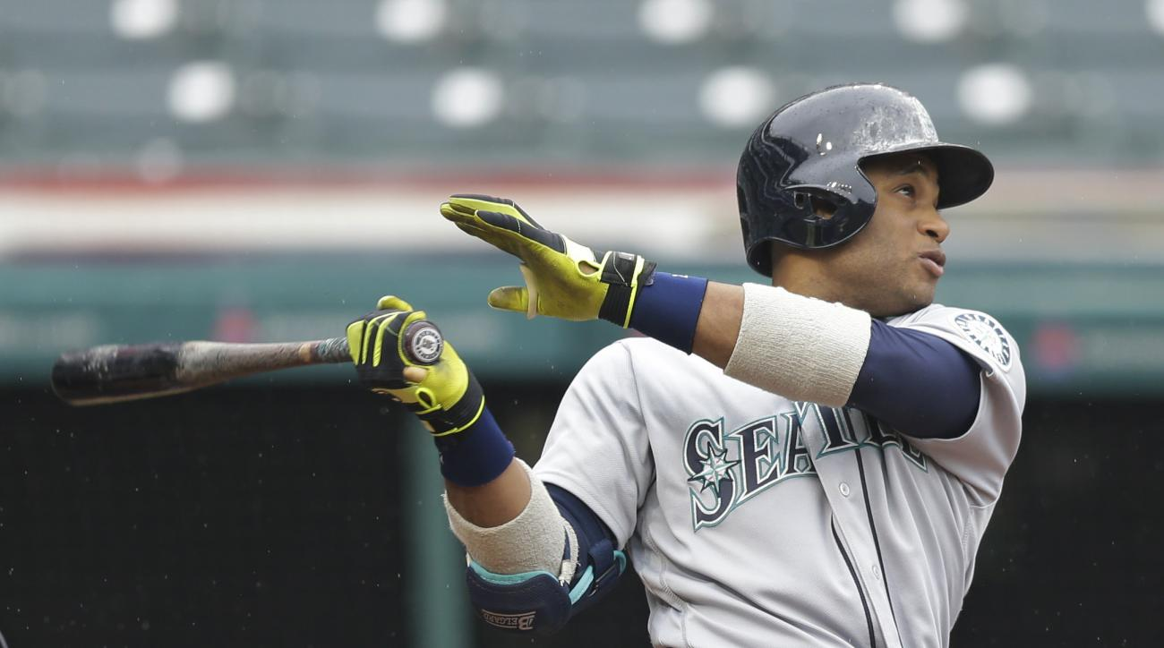 Seattle Mariners' Robinson Cano watches his ball after hitting a three-run home run off Cleveland Indians relief pitcher Cody Allen in the tenth inning of a baseball game, Thursday, April 21, 2016, in Cleveland. Franklin Gutierrez and Luis Sardinas scored