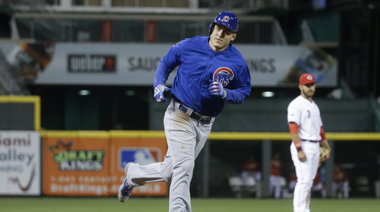 Chicago Cubs' Anthony Rizzo rounds third after hitting a three-run home run off Cincinnati Reds starting pitcher Tim Melville during the sixth inning of a baseball game Thursday, April 21, 2016, in Cincinnati. (AP Photo/John Minchillo)