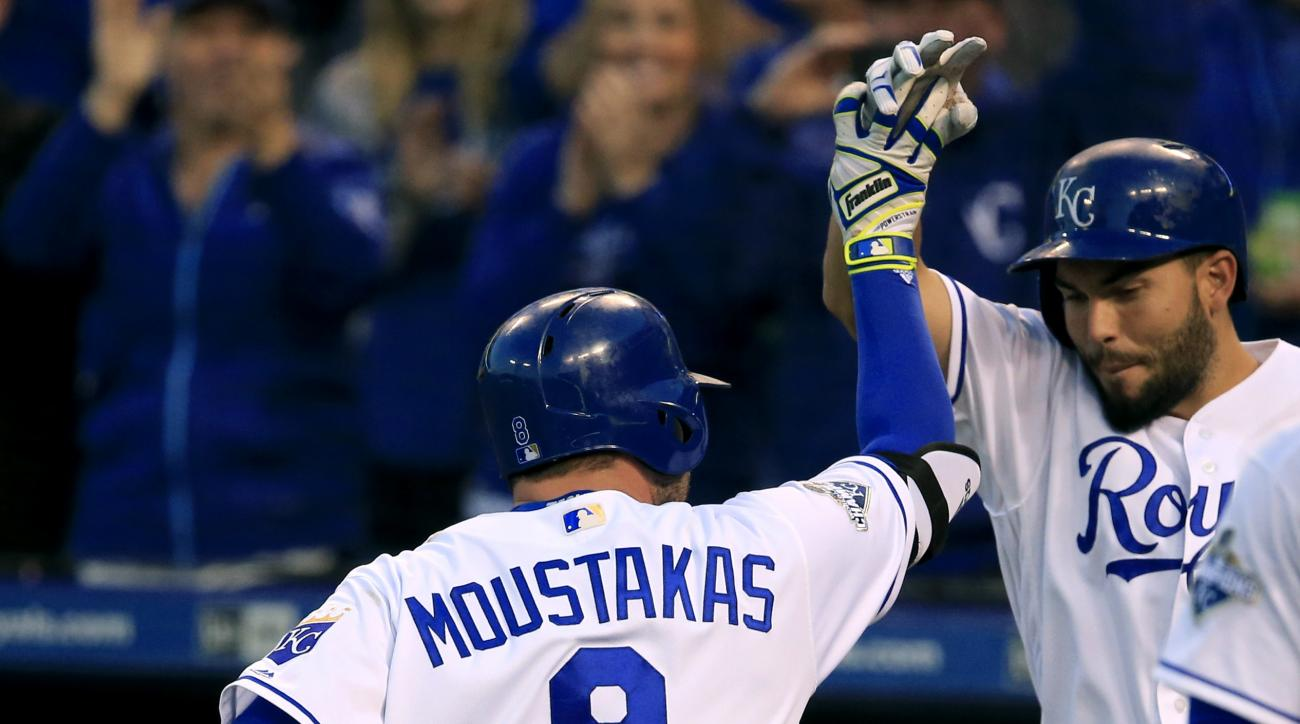 Kansas City Royals' Mike Moustakas (8) is congratulated by teammate Eric Hosmer, right, after his solo home run during the fourth inning of a baseball game against the Detroit Tigers at Kauffman Stadium in Kansas City, Mo., Thursday, April 21, 2016. (AP P