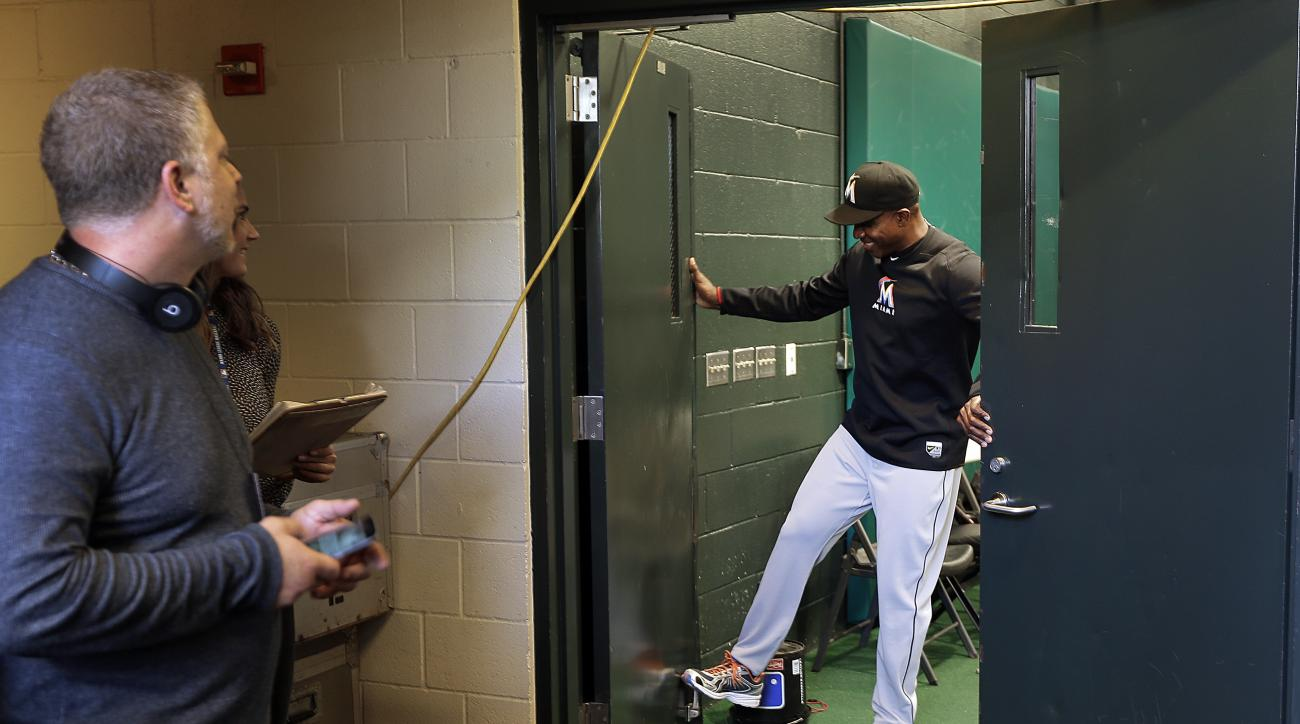Miami Marlins hitting coach Barry Bonds, right, closes doors to the indoor batting cage to reporters prior to the Marlins' baseball game against the San Francisco Giants on Friday, April 22, 2016, in San Francisco. (AP Photo/Ben Margot)