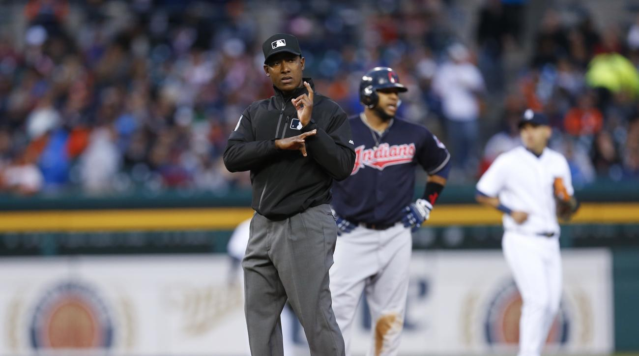 Second base umpire Ramon De Jesus, front, relays outs to another umpire in the third inning of a baseball game between the Detroit Tigers and the Cleveland Indians, Friday, April 22, 2016, in Detroit. (AP Photo/Paul Sancya)
