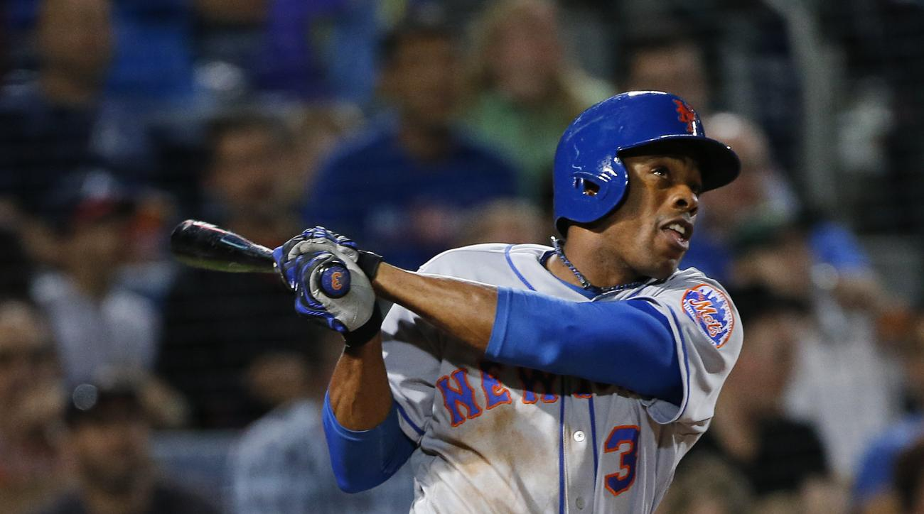 New York Mets' Curtis Granderson (3) follows through on a solo home run in the fourth inning of a baseball game against the Atlanta Braves, Friday, April 22, 2016, in Atlanta. It was Granderson's second home run of the night. (AP Photo/John Bazemore)