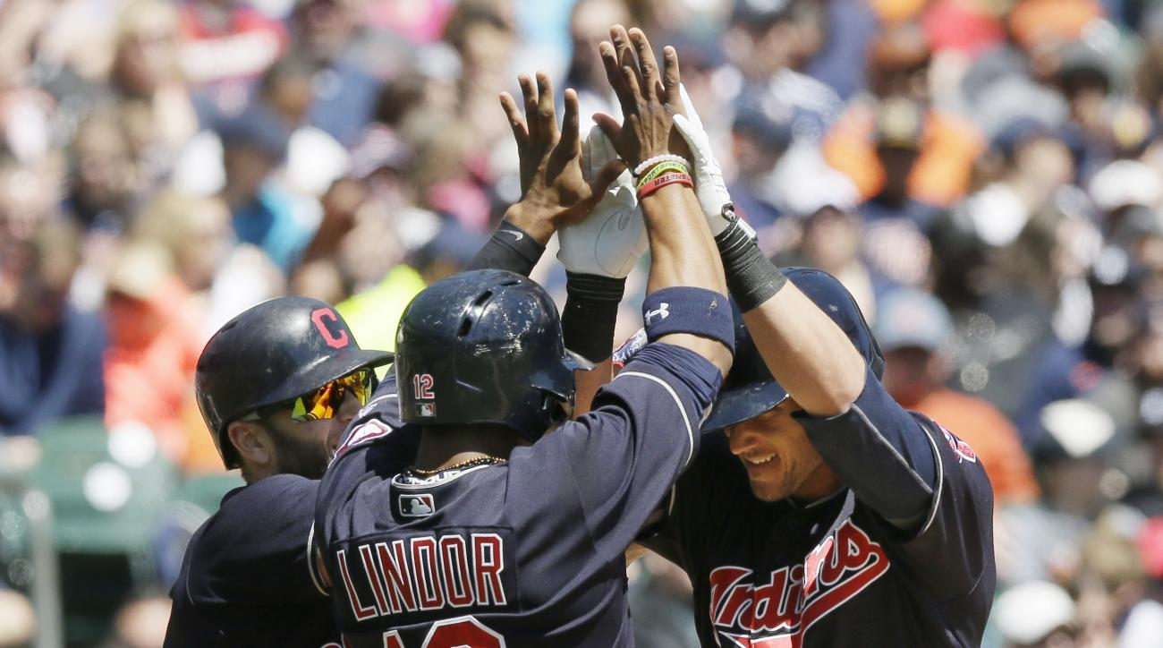 Cleveland Indians' Yan Gomes, right, is congratulated by teammates Mike Napoli, left, and Francisco Lindor (12) after Gomes' three-run home run during the third inning of a baseball game against the Detroit Tigers, Saturday, April 23, 2016, in Detroit. (A